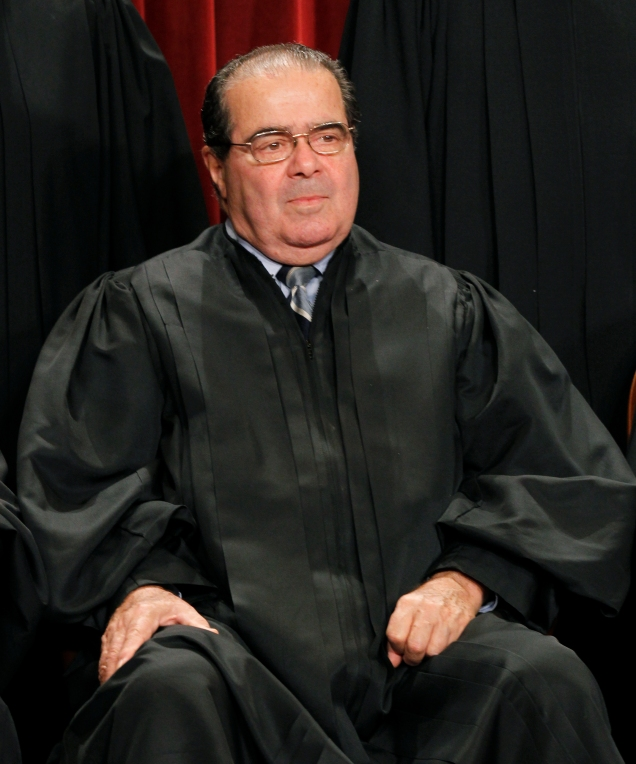 Associate Justice Antonin Scalia during the group portrait of the U.S. Supreme Court at the Supreme Court Building in Washington, Friday, Oct. 8, 2010. (AP Photo/Pablo Martinez Monsivais)